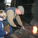 School Group Blacksmithing at Ross Farm Museum